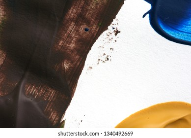 Oil acrylic paint brush strokes in brown on white canvas area with copyspace area for art based designs and backgrounds