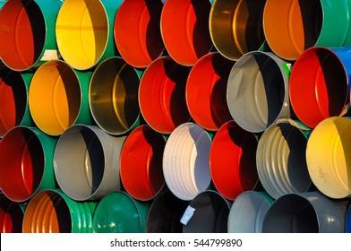 Oil barrels. Oil barrels background texture. Colorful metal barrels. Stack of oil barrels