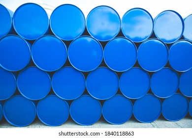 Oil barrels blue or chemical drums horizontal stacked up