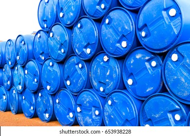 Oil barrels blue chemical drums horizontal stacked up.Used barrels were stacked for reuse again.Oil barrels blue chemical drums used equipment from oil and gas refinery petrochemical industrial.