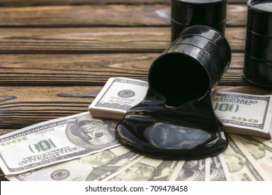 Oil barrels and poured money dollar currency. bargaining. Exchange. oil business. Profit income. market. prices rise, profit from sales of petroleum products.