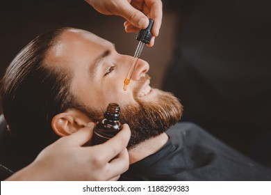 Oil for beard in dropper, process hair.