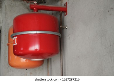 Oil boiler red balloon installation in the garage
