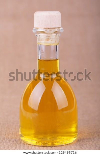oil  in a bottle on sacking background