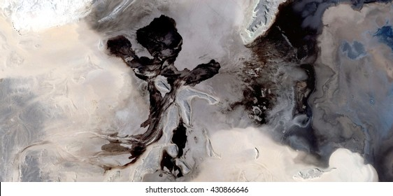 oil boy, black gold, polluted desert sand, tribute to Pollock, abstract photography of the deserts of Africa from the air, bird's eye view, abstract expressionism, contemporary art,