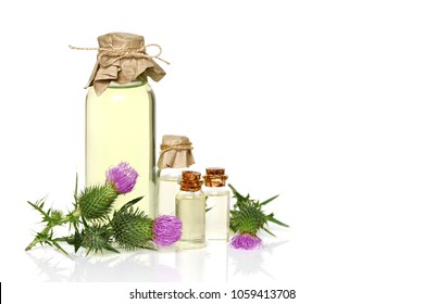 oil burdock pure. Burdock oil set for Hair.Burdock Natural Cosmetics for Hair.plant burdock (Arctium lappa) oil in a bottle on a white background