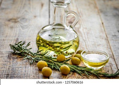 oil in carafe with spices and olive on wooden background mock-up