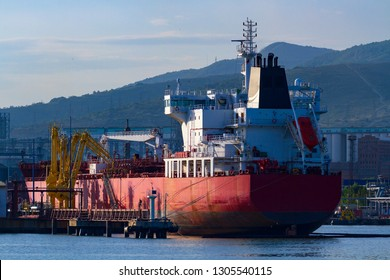 Oil or chemical tanker in a port, evening light