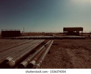 Oil country tubular goods OCTG storage yard in desert