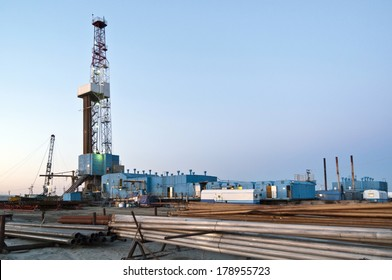 Oil derrick and drilling pipes