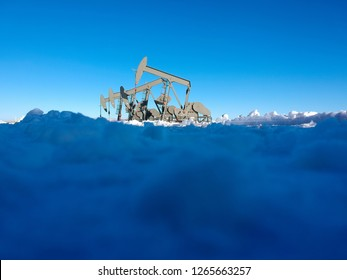 Oil derricks working in a desolate and snowy winter landscape.