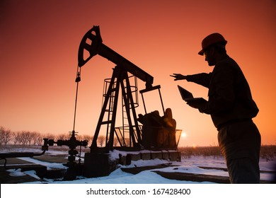 Oil Drill, field pumpjack silhouette with setting sun and worker