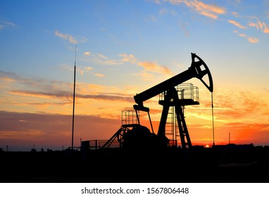 Oil drilling derricks at desert oilfield for fossil fuels output and crude oil production from the ground. Oil drill rig and pump jack background, texture. Belarus, Rechitsa region