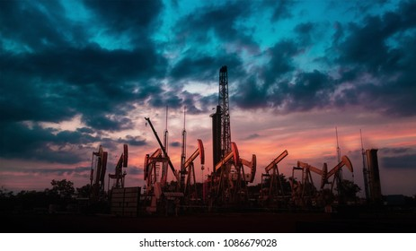 Oil Drilling Rig with group of oil pump or jackpump or Donkey pump with twilight beautiful sky