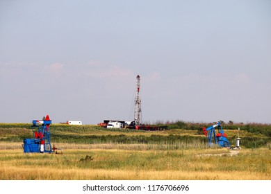 oil drilling rig and pump jacks on oilfield