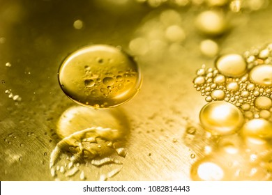 Oil drops and bubbles on a metal gear engine surface. Closeup photo.