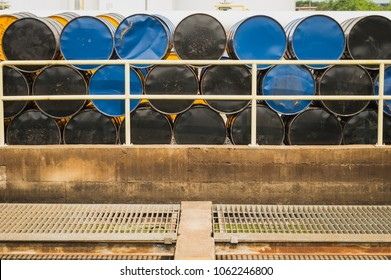Oil Drums ,stack of oil drums,Used 55 gallon chemical drums in a storage yard awaiting recycling.At the industrial event is a warehouse of  barrels of hydrocarbons.