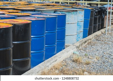Oil Drums ,stack of oil drums,Used 55 gallon chemical drums in a storage yard awaiting recycling.hazardous waste of black and blue tank oil.