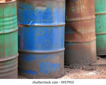 Oil Drums -- they are old and rusty and in various colors