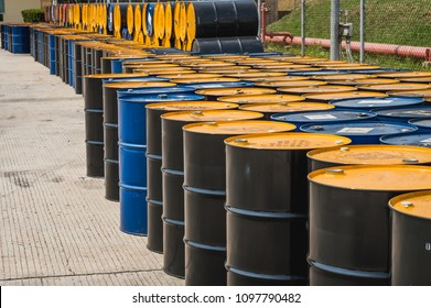 Oil Drum,stack of oil drums,Used 55 gallon chemical drums in a storage yard awaiting recycling.At the industrial event is a warehouse of barrels of hydrocarbons.Industry oil barrels .