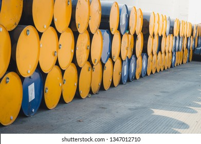 Oil Drum,stack of oil drums,Used 55 gallon chemical drums in a storage yard awaiting recycling.At the industrial event is a warehouse of barrels of hydrocarbons.Industry oil barrels