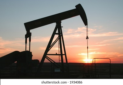 Oil field Pump Jack with setting sun