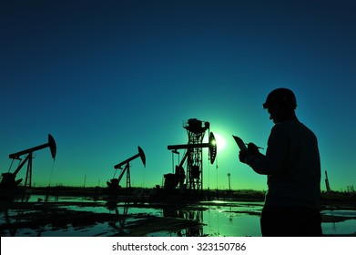 Oil field oil workers at work