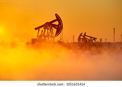 The oil fields sunrise landscape.