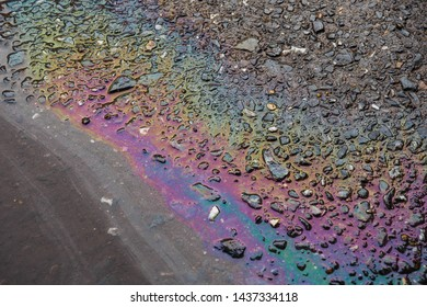 Oil film on surface of the water. Oil film pollution. Colorful  oil film on water.