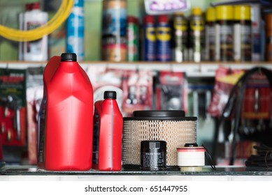 Oil filter, Air Filter, Oil lubricant, Fuel Filter and Cabin or Air Conditioner Filter  in the auto parts shop.