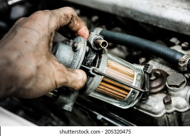 oil filter gas mechanic working in auto repair shop