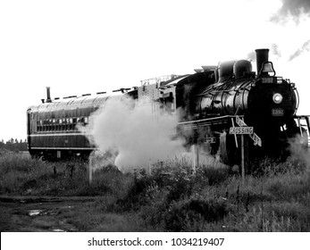 Oil fired steam locomotive works its way across a prairie landscape.  This H6g class 4-6-0 locomotive saw service from 1913 through the 1950s