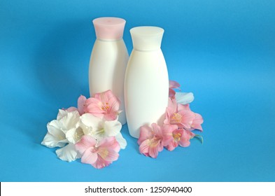 Oil flower orchid nutrition. Bottle shampoo and conditioner with exotic flower blue background. Damaged hair sulfate and paraben free shampoo. Shampoo important hair natural moisture. Beauty product.