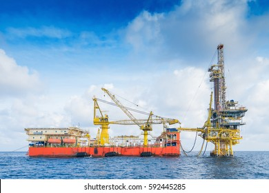 Oil and Gas business in the gulf of Thailand, Drilling Rig working on production wellhead remote platform to completion on gases and crude oil well.