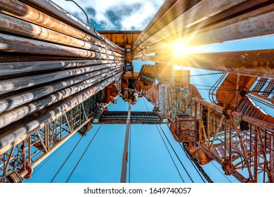 Oil and Gas Drilling Rig onshore dessert with dramatic cloudscape. Oil drilling rig operation on the oil platform in oil and gas industry