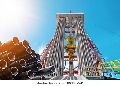 Oil and Gas Drilling Rig. Oil drilling rig operation on the oil platform in oil and gas industry. Top drive system of drilling rig