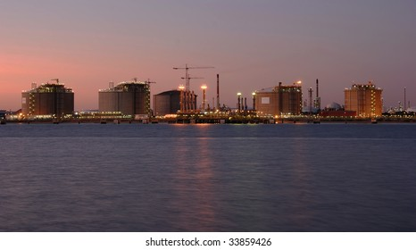Oil and gas factory big refinery by night. Panorama.