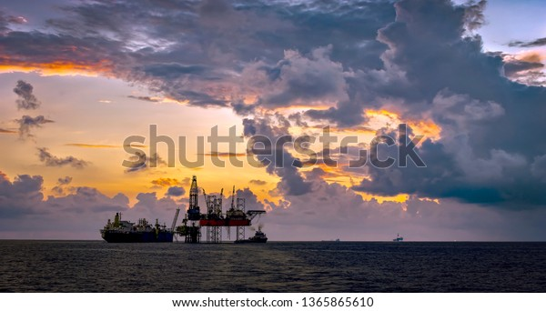 oil and gas field industry with beautiful sunset cloudy sky background
