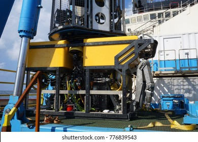 Oil and gas industrial. A yeloow and black frame commercial Remote Operated Vehicle (ROV) for deep sea survey purpose standby on the mini platform awaiting for launching to the sea.