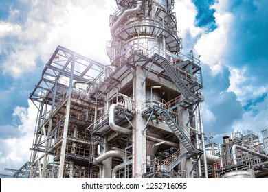 Oil and gas industrial,Oil refinery plant form industry,Refinery factory oil storage tank and pipeline steel with sunset and cloudy sky background,Thailand