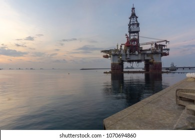 Oil and gas industries. Semi submersible rig for deep sea floating at port with sunrise view.