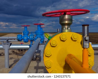 Oil and gas industry. Beautiful high pressure gas valve yellow. Pipeline