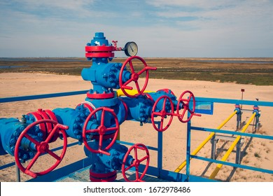 Oil, gas industry. Group wellheads and valve armature , Gas valve, Gas well of high pressure, toned