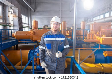 Oil, gas industry. The mechanic - the repairman, gas production operator opens the valve, gas equipment and fitting, toned.