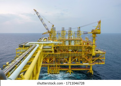 Oil and gas industry at offshore. Daylight scene at oil and gas platform complex at process area with pipelines and valves.