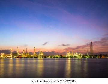 Oil and gas industry - petrochemical plant  with reflection over the river