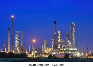 Oil and gas industry ,Oil refinery plant at twilight with sky  in night time background.