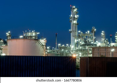 Oil and gas industry, steel pipe equipment of petrochemical plants at night