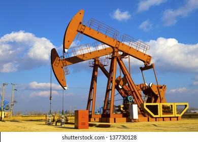 Oil and gas industry. Work of oil pump jack on a field.