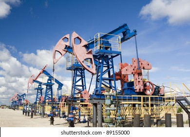Oil and gas industry. Work of oil pump jack on a oil field in desert